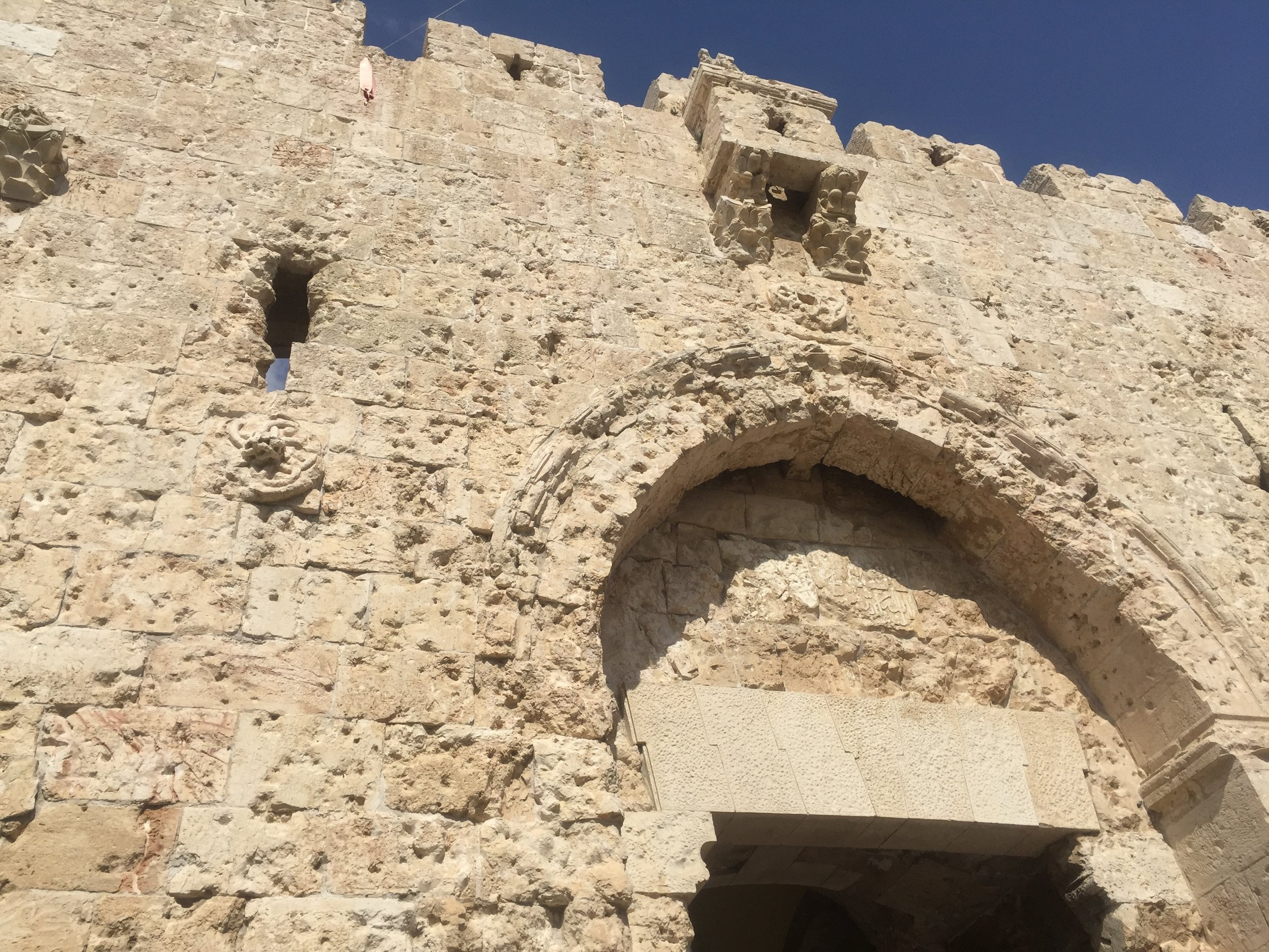The walls are pock-marked with the bullet holes from past conflicts.